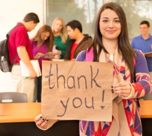 College student with thank you sign