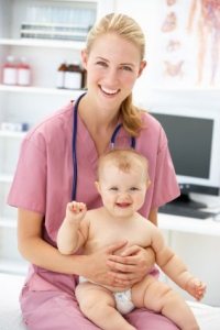 pediatrician holding a baby
